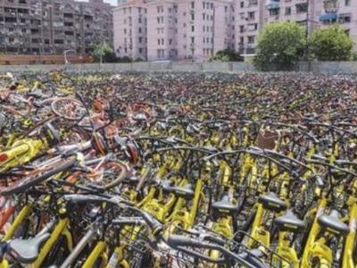 """万辆废弃单车""""暂存费""""近百万 单车企业不能管""""投""""不管""""收"""""""